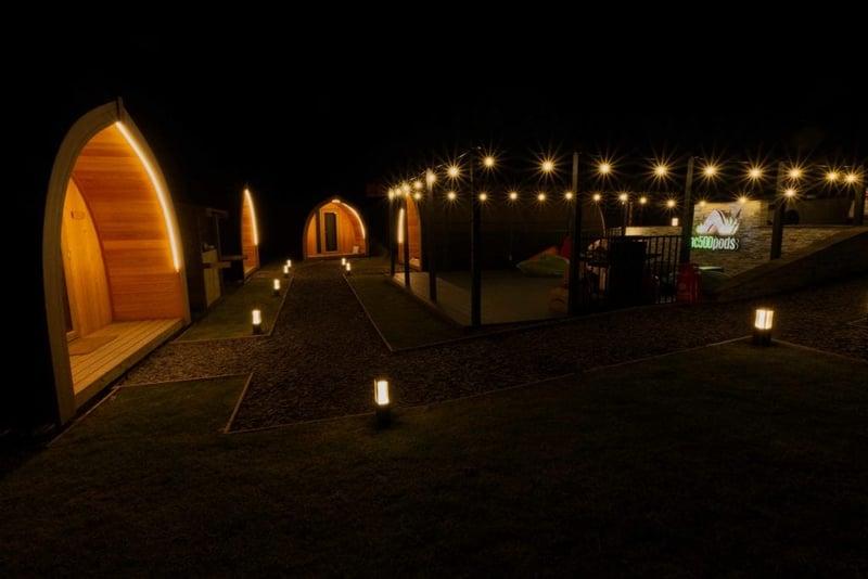 Glapmping pods outside night lighting
