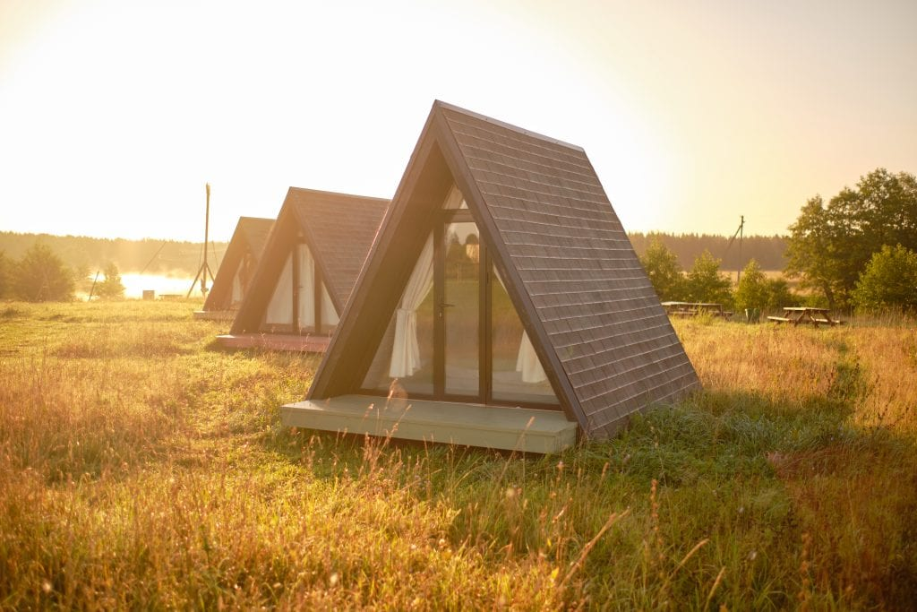 Modern glamping pods in scenic field area